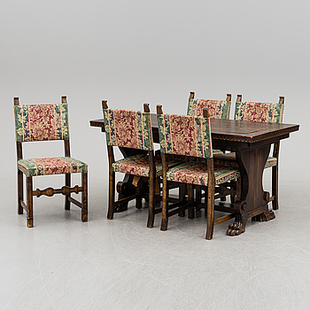 A 1930/40's  dining table with 5 chairs.