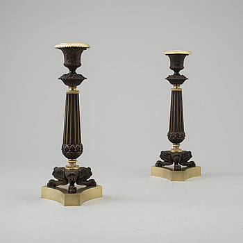 EMPIRE, A pair of French bronze Empire candlesticks, mid 19th Century.