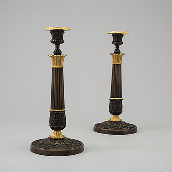 EMPIRE, A pair of French bronze Empire candlesticks, first half of the 19th Century.