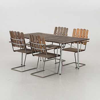 A GARDEN TABLE AND FOUR ARMCHAIRS FORM GRYTHYTTAN.