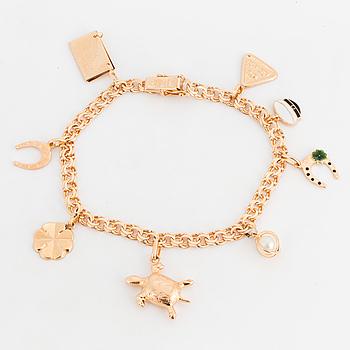 18K gold charm bracelet.