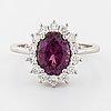 A rhodolite garnet and brilliant cut diamond ring