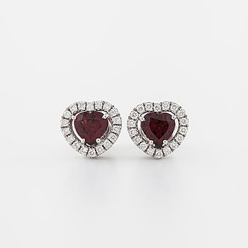 A pair of rhodolite garnets and brilliant cut diamond earrings.