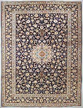 A Keshan rug, signed, 405 x 301 cm.