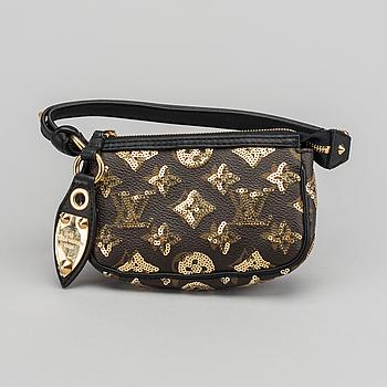 f0b7d5e5935f A louis Vuitton Gold Monogram Eclipse Mini Pochette Bag.
