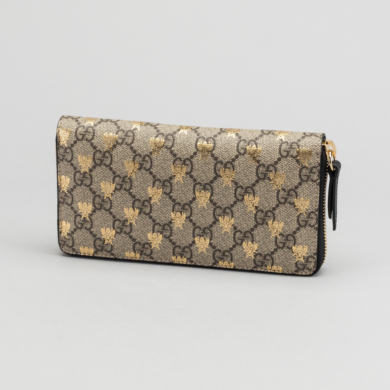 4e14b8f6bbfb A Gucci supreme bees wallet. - Bukowskis