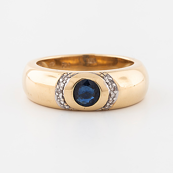 A sapphire and brilliant cut sapphire ring.