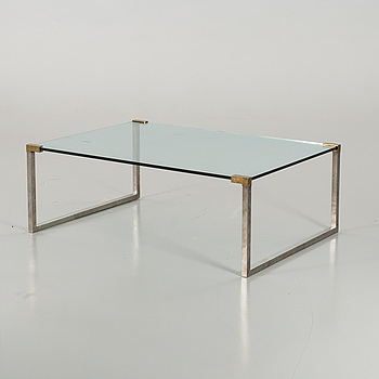 A GLASS TOP COFFEE TABLE SECOND HALF 20TH CENTURY.