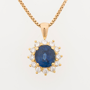 A PENDANT, facetted sapphire, brilliant cut diamonds, 18K gold.