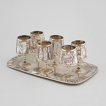 Six liqeur glasses on a tray, mother of pearl and alpaca, Mexico, second half of the 20th century.