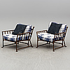 A pair of contemporary garden easy chairs in metal imitating bamboo.
