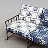 A contemporary bamboo imitating garden sofa.