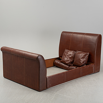 An Italian leather upholstered bedframe.