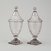A pair of glass lidded vases, 18th/19th century.