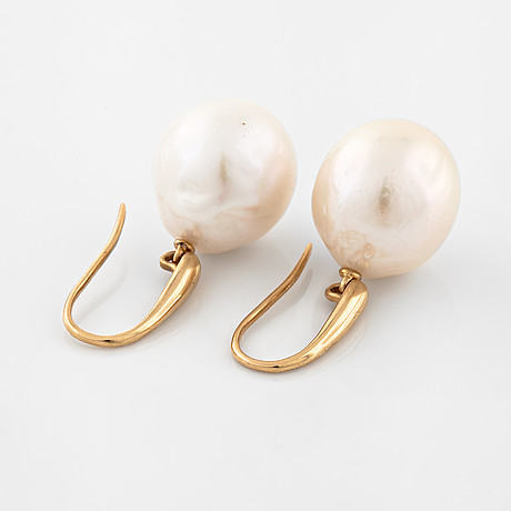 A pair of cultured pearl earrings.