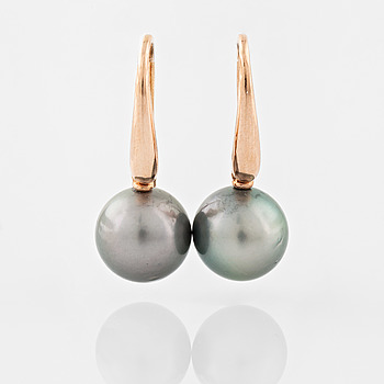 A pair of cultured Tahiti pearl earrings.