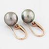 A pair of cultured tahiti pearl earrings.
