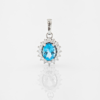 PENDANT, A topas and brilliant cut diamond pendant.