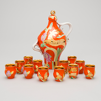 A 13-piece porcelain vodka set by Dulevo, USSR, second half of 20th Century.