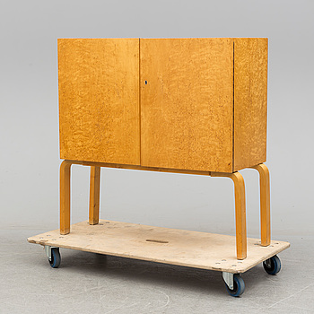 ALVAR AALTO, a mid 20th century burr birch veneered cabinet, model 810, Finland.