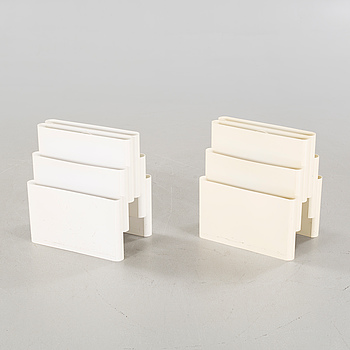 A pair of magazine racks, designed by Giotto Stoppino  for Kartell.
