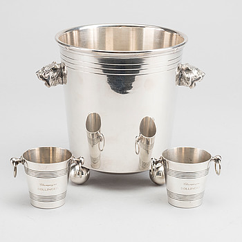 A plated ice bucket and two miniature Bollinger ice buckets. Mid 20th century / latter.