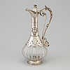 A first half of the 20th century silver and glass wine jug