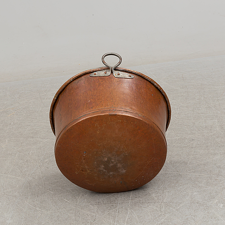 A 19th century copper cauldron.