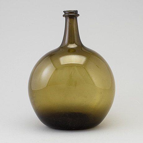 A 18th century glass bottle.