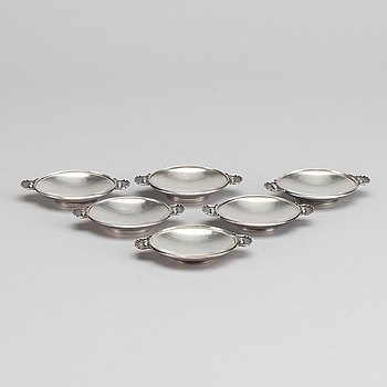 A Danish 20th century sterling set of six ashtrays, mark of G Jensen Copenhagen first half of the 19th century.