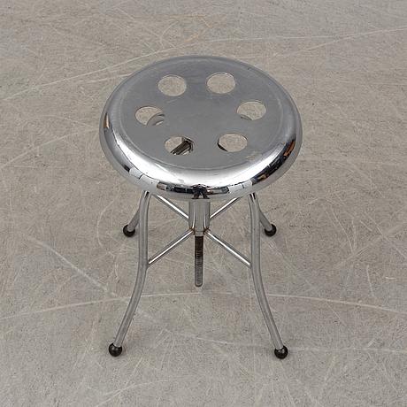 A chromed metal stille stool