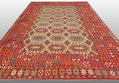 An oriental kilim, around 510 x 305 cm.