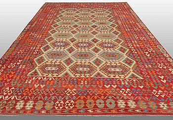 An oriental kilim, around 510 x 305 cm.