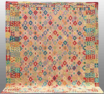 An oriental kilim, around 290 x 250 cm.