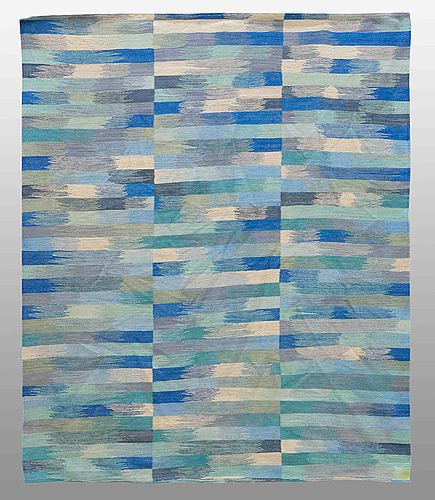 A carpet, flat weave, around 228 x 185 cm.