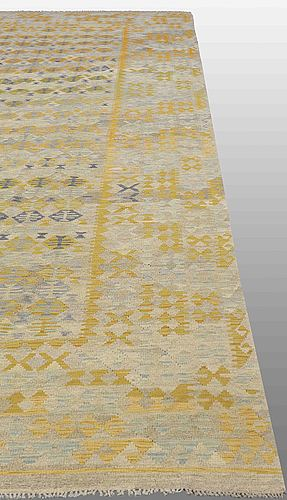An oriental kilim, around 491 x 308 cm.