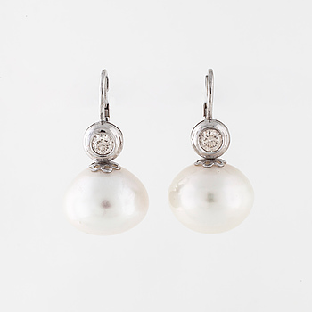 A pair of cultured pearl and brilliant cut earrings.