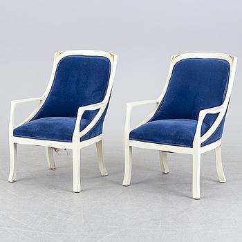 A pair of art nouveau armchairs.
