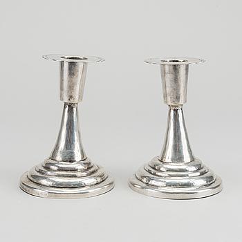 LJUSSTAKAR, ett par, silver, Sydamerika, 1900-talets första del.