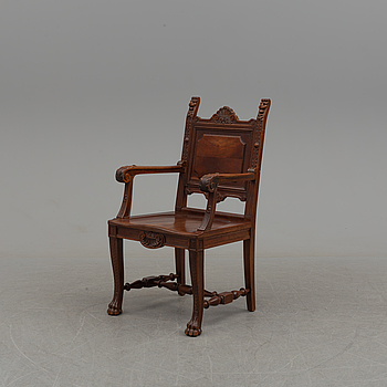 An end of the 20th century oak arm chair.
