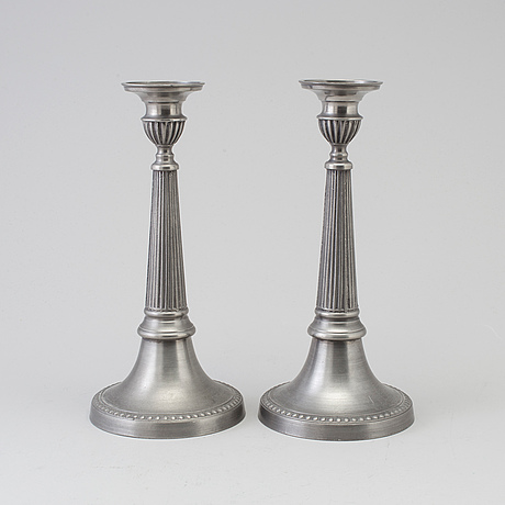 A pair of pewter candle sticks by b o santesson stockholm 1983.