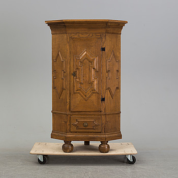 A second half of the 20th century Baroque style corner cabinet.