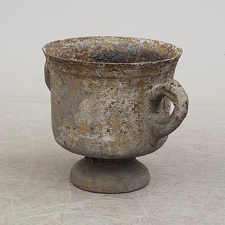 A 19th century cast iron garden urn.