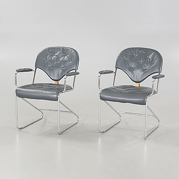 A pair of chairs by Sam Larsson for Dux, designed in 1974.