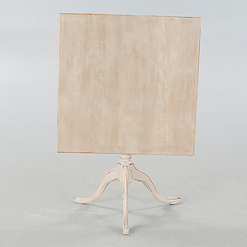A 19th century drop-leaf table.