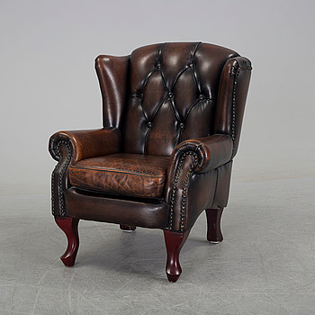 A children's leather upholstered wing chair, late 20th Century.