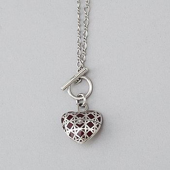 A Christian Dior costume jewelry pendant.