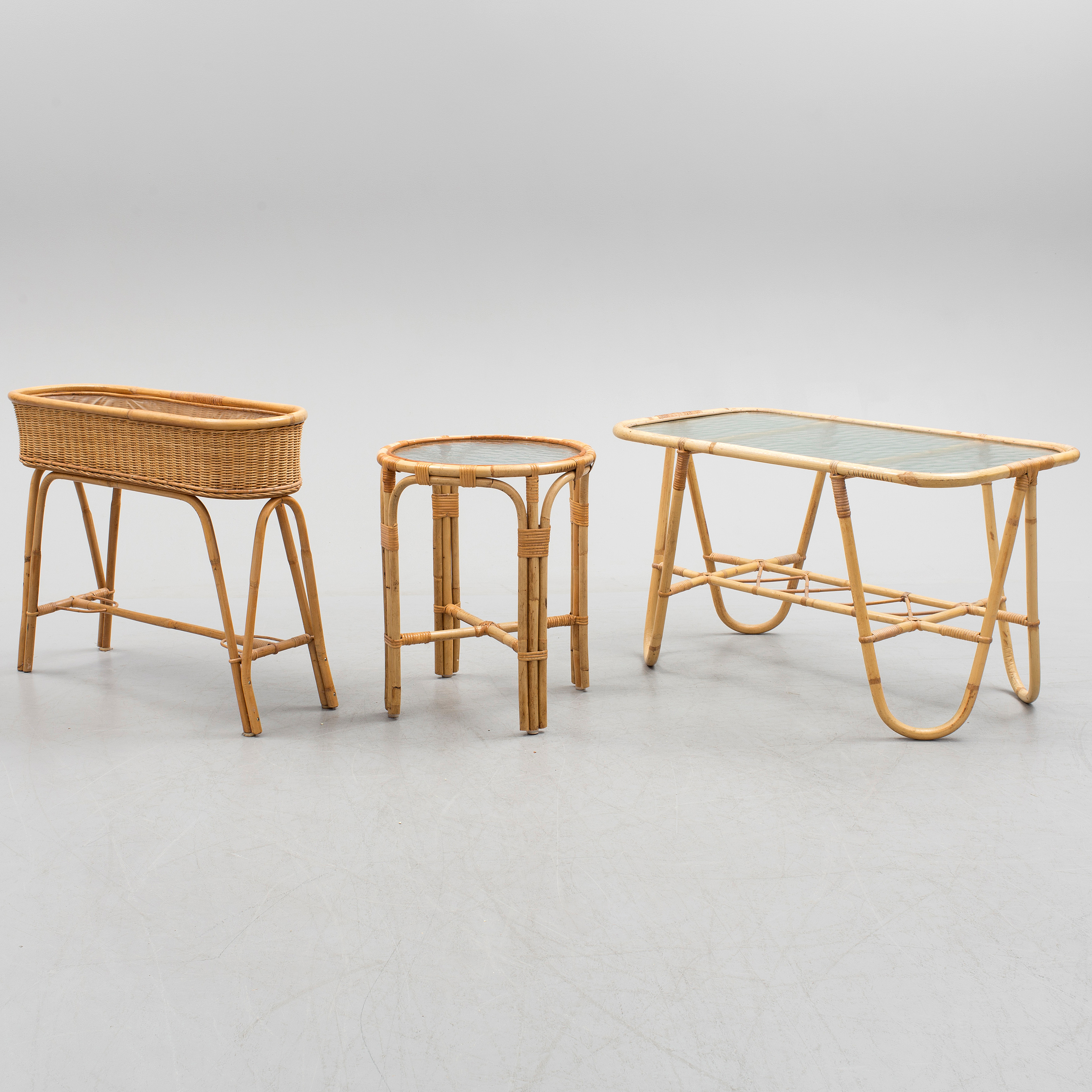 A Bamboo And Rattan Coffee Table Side Table And Plant Stand Bukowskis