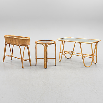 a bamboo and rattan coffee table, side table and plant stand.