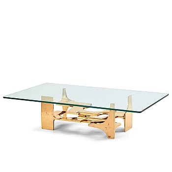 98. Gerard Mannoni, a polished bronze and glass sofa table, France 1974.